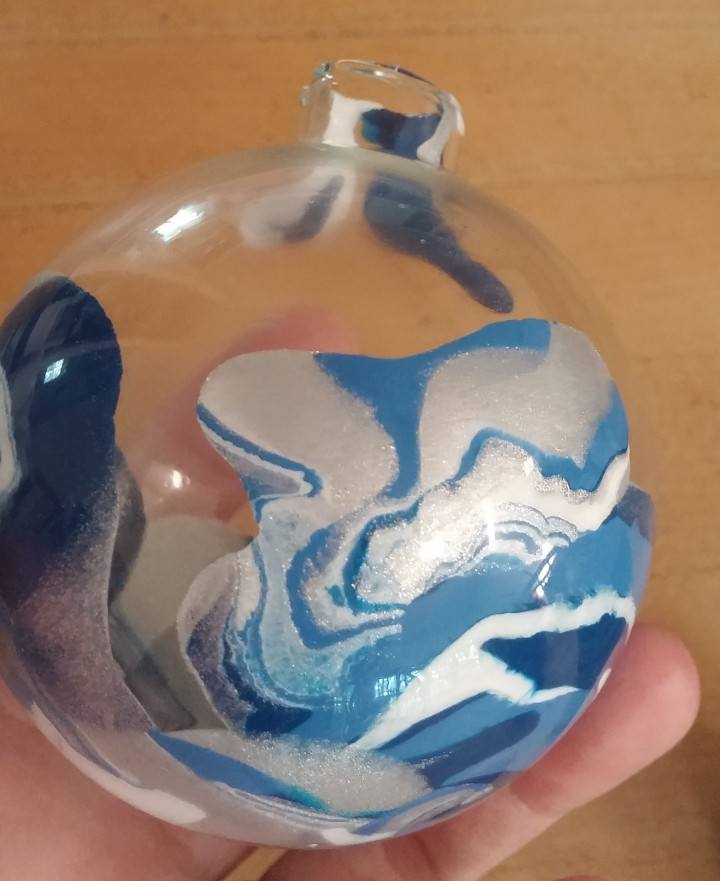 paint in a clear glass ornament