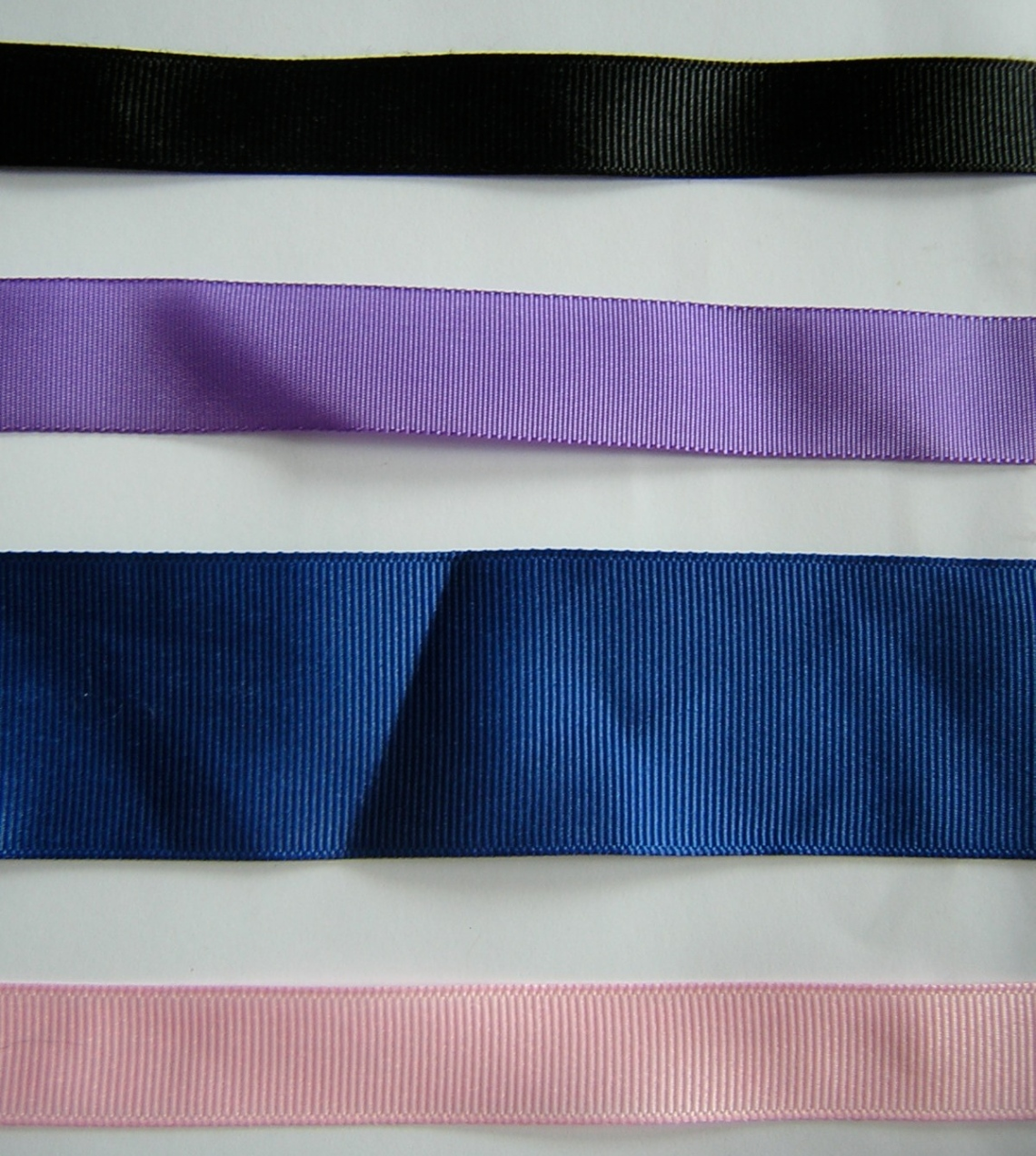 A picture of 4 different grosgrain ribbons